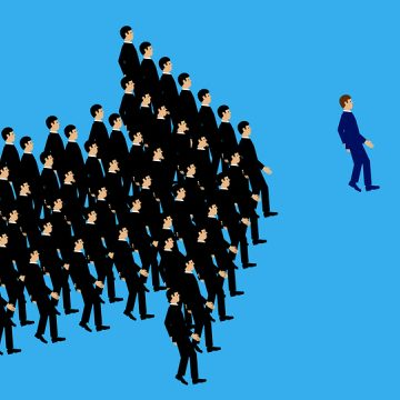 A vector illustration of businessmen following the leader in the formation of an arrow shape. A metaphor on teamwork and leadership.